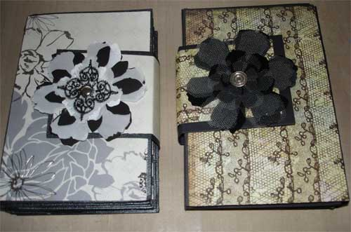 two hand made mini albums shaped like a clutch purse