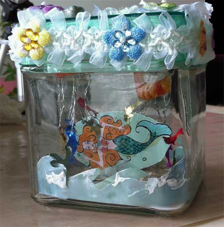 altered jar with fish and mermaid inside, side view