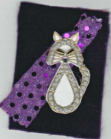 artist trading card with velvet background and cat image outlined with beads