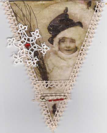 pennant for Christmas panner showing image tranfser of a vintage child in a snow storm