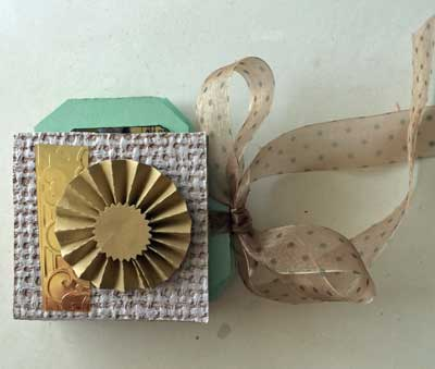 front of mini journal showing gold embossing and rosette
